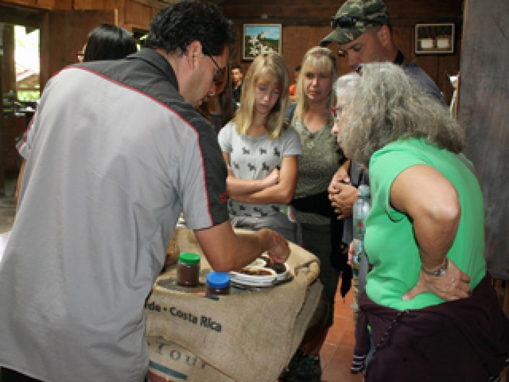 Junior giving a coffee tour in Monteverde