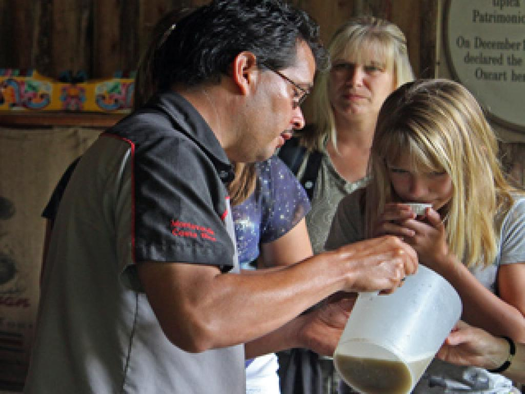 Tasting Sugar Cane Juice on Don Juan Coffee Tour Monteverde